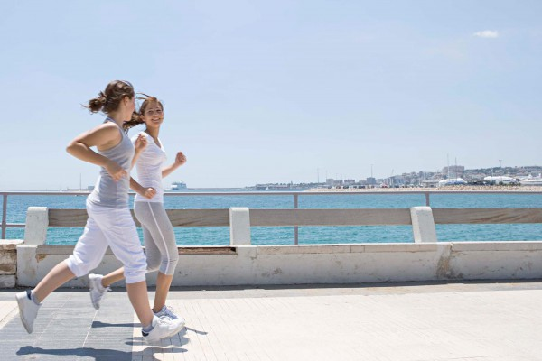 Girls Jogging by the shore