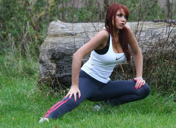 Workout in the park, girl streching out