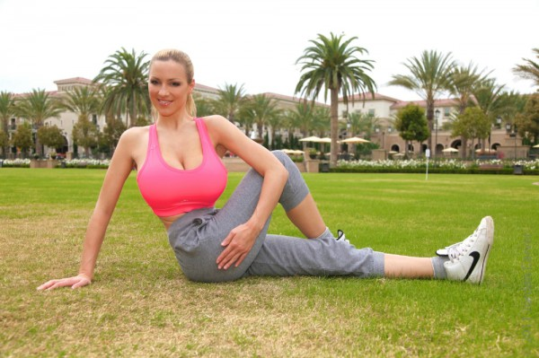 Jordan Carver stretching in the park
