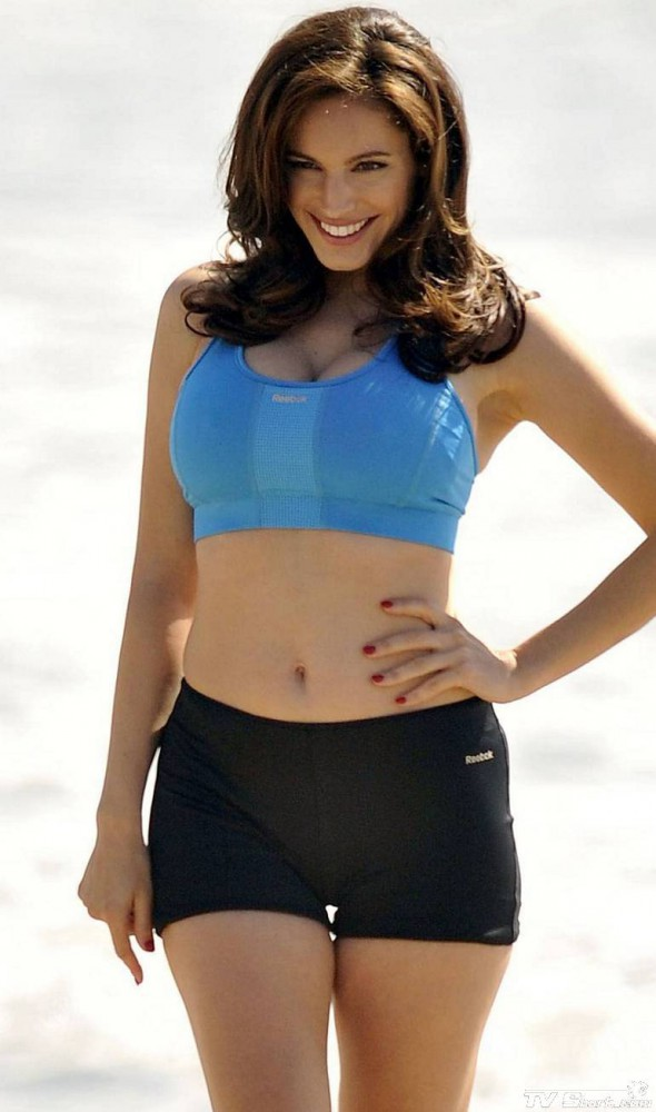 Kelly Brook working out on the beach