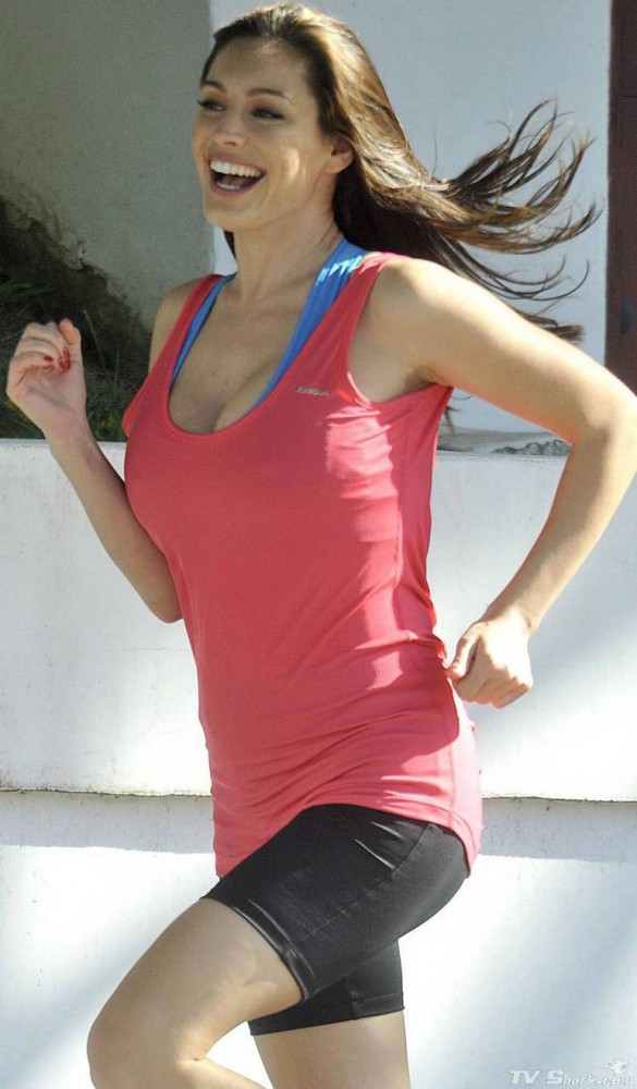 Kelly Brook in a red fitness outfit