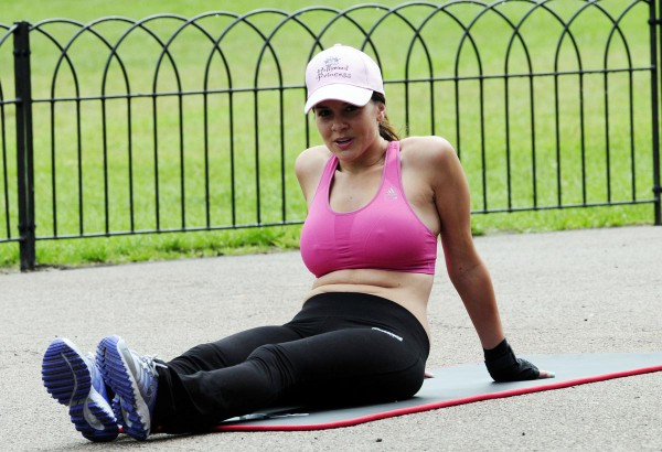 Imogen Thomas doing Crunches